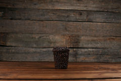 Coffee cup to go. To go cup of coffee made of coffee beans, do it yourself project royalty free stock images