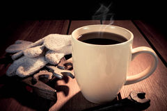 Coffee cup and Tools on a wooden table. Dark background. Royalty Free Stock Photo