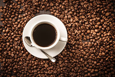 Coffee cup top view on beans background Stock Images