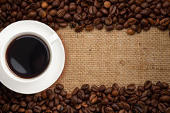 Coffee cup top view on burlap background Stock Images