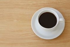 Coffee cup top view. On the desk Royalty Free Stock Photo