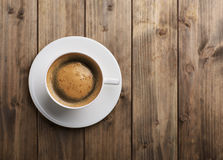 Coffee cup top view. On old wooden background Stock Photography