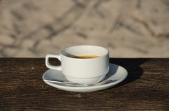 Coffee cup top view on old wooden. Close up Coffee cup on table and view of tropical beach, coffee with sweetened condensed milk famous drink in Thailand call Stock Photography