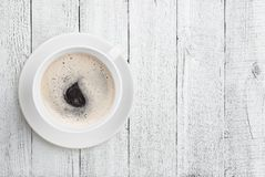 Coffee cup top view on white wood table background Stock Photo