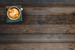 Coffee cup top view on wooden table. Background Royalty Free Stock Photography
