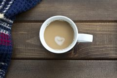 Coffee cup top view on wooden table background. stock photos
