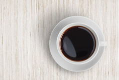 Coffee cup top view on wooden table Stock Images