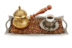 Coffee cup, tray with arabic decoration and coffeepot isolated on a white background. Turkish coffee cup, tray with arabic decoration and coffeepot isolated on a royalty free stock images