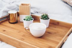 Coffee cup on tray. Styled morning at home. Toned image royalty free stock images