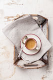 Coffee cup in tray. Coffee cup in Vintage tray on beige background royalty free stock image