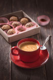 Coffee cup and truffles Royalty Free Stock Photo