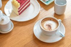 Coffee cup and velvet red cake, morning set Stock Photo