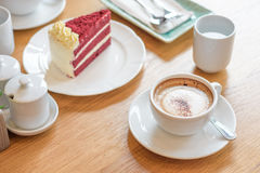Coffee cup and velvet red cake, morning set Stock Image