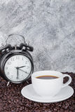 Coffee in cup and vintage clock Coffee time concept with wall Royalty Free Stock Photos