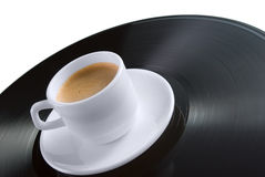 Coffee-cup on vinyl record Stock Images