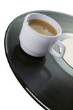 Coffee-cup on vinyl record Stock Image