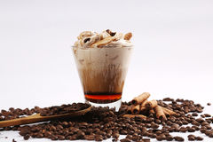 Coffee cup with whipped cream with chocolate sticks Royalty Free Stock Photography
