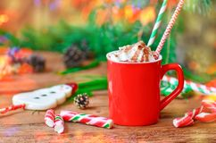 Coffee cup with whipped cream on wooden table. Cup of espresso coffee with chocolate and whipped cream Stock Photo