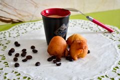 COFFEE CUP WHIT A CREAM BALLS royalty free stock photo