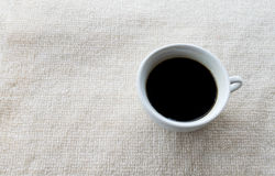Coffee cup on white carpet Royalty Free Stock Image