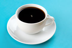 Coffee cup. White cup of fresh coffee on blue background Stock Photos