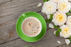 Coffee cup and white rose flowers Stock Photography