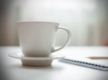 Coffee cup on white table Stock Photography