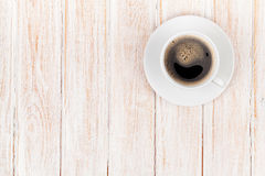 Coffee cup on white wooden table Stock Images