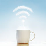 Coffee cup with wifi cloud Stock Image