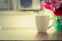 Coffee cup beside window Royalty Free Stock Image