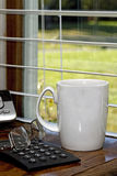 Coffee Cup by Window Royalty Free Stock Photos