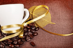 Coffee Cup With Yellow Ribbon Stock Image