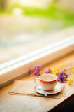 Coffee cup on wood bar in cafe. Coffee cup on wood bar beside window at coffee shop in afternoon time royalty free stock images