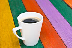 Coffee cup on wood colorful Stock Image