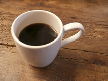 Coffee Cup on Wood Table Stock Photography