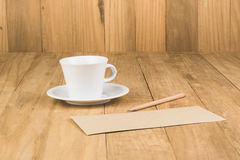 Coffee cup on wood table Royalty Free Stock Photography