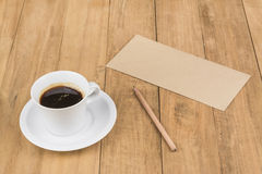 Coffee cup on wood table Stock Photos