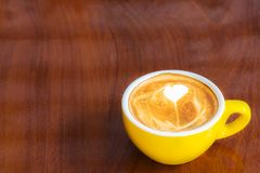 Coffee cup on wood table. royalty free stock photography