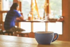 Coffee cup on wood table royalty free stock images