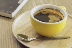 Coffee cup on wood table in cafe. royalty free stock photos