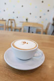 Coffee cup on wood table Stock Image