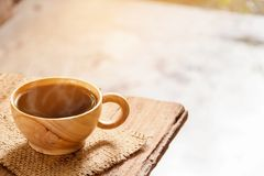 Coffee cup on wood table. And good morning Stock Photography