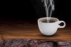 Coffee Cup on Wood Table Stock Images