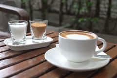 Coffee in cup on wood table in morning time. Background Royalty Free Stock Photography