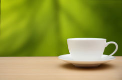 Coffee cup on wood table.nature background.  Stock Photography