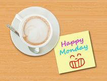 Coffee cup on wood table with paper note Royalty Free Stock Images