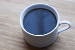 Coffee cup on wood table Royalty Free Stock Photo