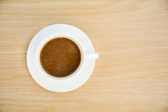 Coffee cup on wood table.Top view. Stock Photos
