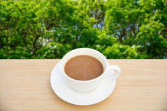 Coffee cup on wood table.Top view nature backgrounds.  Royalty Free Stock Photos