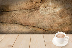 Coffee cup on wood texture. Stock Photo